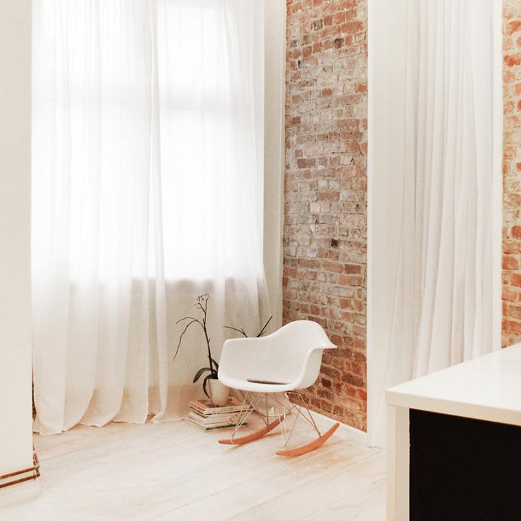 Minimalistisch huis met bakstenen muur als pronkstuk - INTERIOR JUNKIE