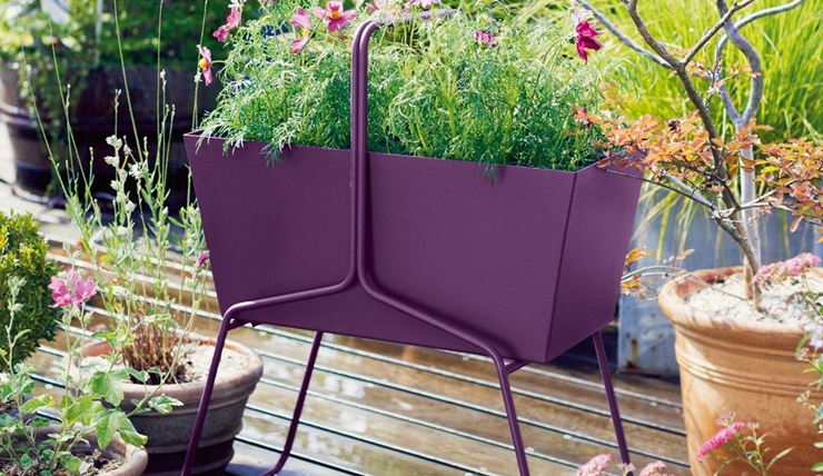 Lekker boho: deze paarse plantenbak